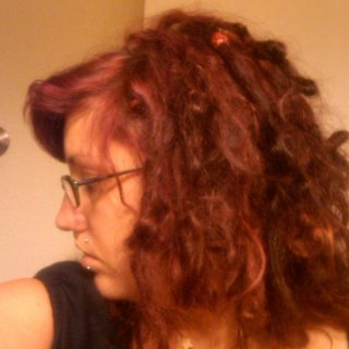 Here is my hair at 4 and a half months old. :)  Left side view... My red looks kinda brown in the dim lighting...