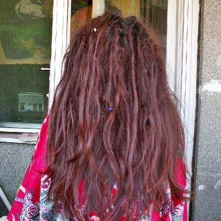 So, I just finished separating, and was so angry with all the loose hair and congoing and general messiness (I have no problem with them usually, this day is an exception), and even started thinking of brushing them out, but then I took a picture of the back of my head, and changed my mind. :D