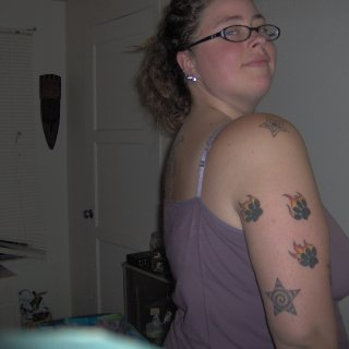 I wish I was this skinny again! Showing off Flaming Kitty paws and both star designs on arm.