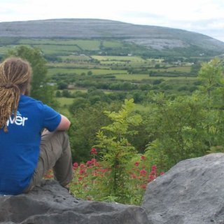 sitting on a rock near Galway in Ireland