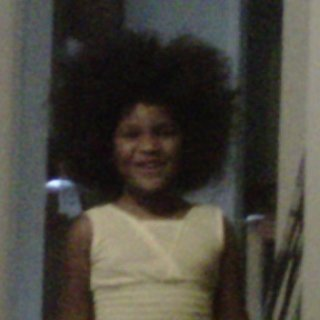 My baby and her afro. This is what I was dealing with before we locked it!!