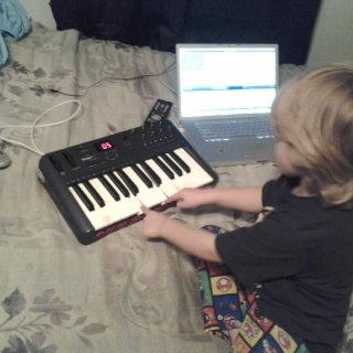 This is my son using my midi keyboard and mac to make a beat hes only 4 but can play the keyboard quite a bit