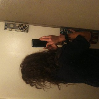 My fuzzy crazy back of me hair. I'm going to miss all the craziness when it dreads up