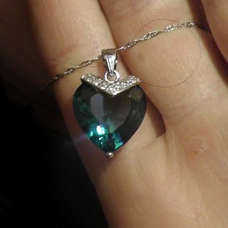 My husband is so good to me! Its a beautiful blue topaz necklace.