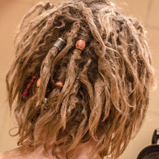I wanted thin uniform dreads but lack of character started to bother me few weeks ago so i forced them to congo with beads and wraps.from 123 to 83 dreads.feels much more like dreadhead now:)