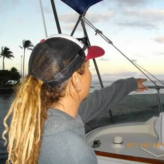 Off of Honolulu Harbor--the sun has bleached my brown dreads to blond--surfing lots.