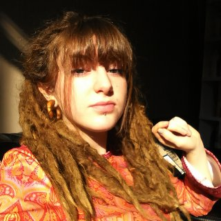 i had just cut my bangs after brushing out 3 of my front dreads