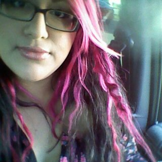 This is a older pic of my hair at 6 weeks and 2 days of natural, free form dreadlocks.. As of right now I am on my 9th week and a lot of my pink dreads have shrunk a lot!