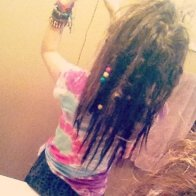 Dreads at about a month and a half (: