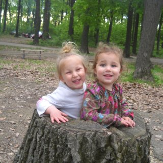 2 lil girls in a log they call home! makes me a proud dad