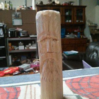 My very first attempt at whittling. I started with a rectangular piece of pine and using only a stanley/box cutting knife made it cylindrical and carved this face into it. Pretty happy for a first attempt :)