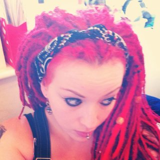 i discovered that once my dreads had calmed down i could slick them back hey presto...