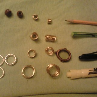 Gold coil jewelry I made, middle thing is a picture frame :D