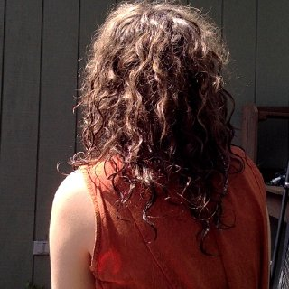 well, it's almost at three months! (i dont kno the exact date i stopped brushing lol) But man it is knotting up like crazy. Nearly all of the back is formed even though you can't really tell that much from the pic :P I also think i'm in a frizzy stage which I don't mind too much, usually just put it in a loose bun when i can't handle it (very humid in upstate NY)n