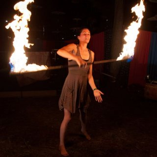 Allison of the Give and Take Jugglers doing a night shoot with her fire staff