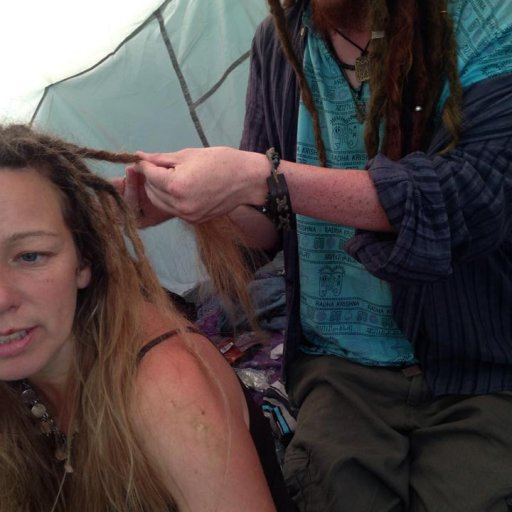 Having hair done at camp