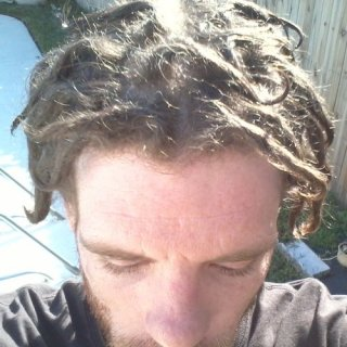 1 month dreads just after a sea salt and lime juice spray. Getting a little vitamin D.