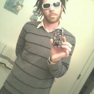 Dreads go so well with nice sweater.