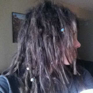 1 year 3 months. So proud of my baby dreads :)