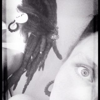 Free-form natural dreadlocks. 3 & 1/2 year journey into locking. 14 years of growth since chopping my first set of locs.