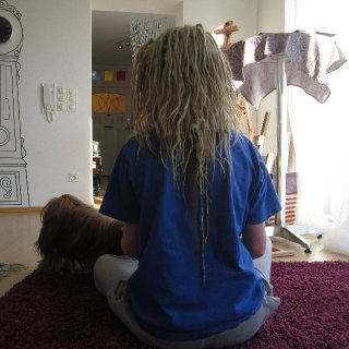 how my gorgeous free formed dreads are looking <3 the long brown thing by the hair wraps is my hair which was in another wrap that I took out :) amazing how much length difference there is