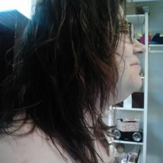Profile view, much more messy looking. Dreads in weeks!