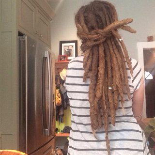 Started letting my hair lock after the birth of my first child. Three & a half years later and expecting my third anytime now. Natural free-form dreadlocks.