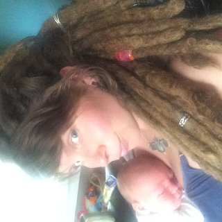 2 week old son. 3.5 year old natural dreadlocks