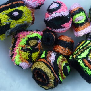 I create Embroidered Fabric Beads. Come see more at www.darkmoondoll.etsy.com
