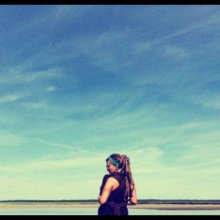 Mama & baby by the sea. Natural dreadlocks.