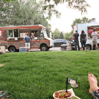 Food truck party! The guy in the striped shirt waiting in front of the truck on the right.. that's my honey :)