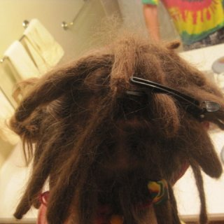i back combed a little then some twist n rip to tighten the knots real deep, then more back combing, just back n forth till i got to the tips, then twist n ripped the tips, and pulled in the loose hair. just in case you're wondering :D