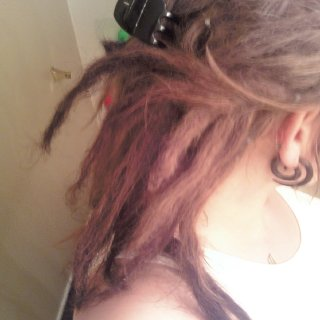day one of my short lived waxed dreads. YUCK! NEVER AGAIN! More photos to come when I finish my new natural dreadies!