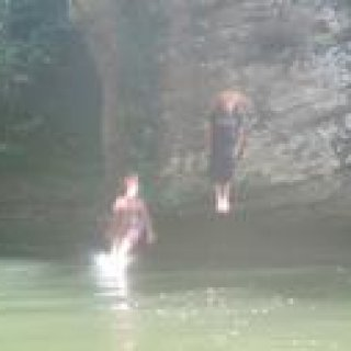 Chris and I jumping off the cliff at Red River Gorge