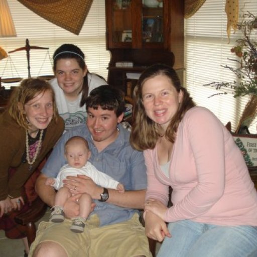 Me and my sisters, Shaunna and Denise, and her husband Johnathan. Baby Ryan's silly face in the middle.