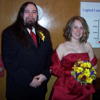 Me and my hub at our friends' wedding. Groomsman and bridesmaid!