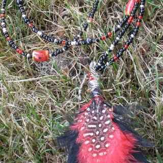 Wire-wrapped feather necklace with glass and ceramic accent beads.