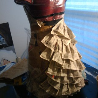 So, I'm playing with recycling things in my art right now, and I'm using phone book pages to make a dress. We'll see how well it goes, bit yeah. :-D