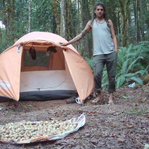 Tate in front of his tent with hazle;nuts