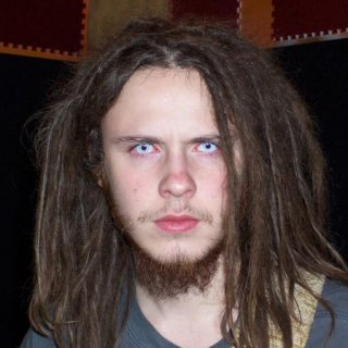 Wearing my contacts. These are also the first set of dreads I had.