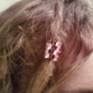 My new peyote sleeve, made with two different shades of pink triangular glass beads. BLINGRIFIC!