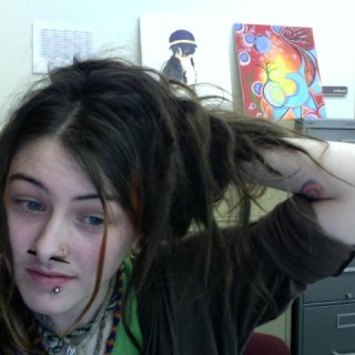 my slightly gloomy face and my dreads at work. I try not to take too many pictures of them since they always look the same to me. Ah, progress where are you?