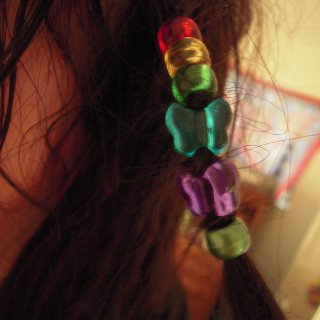 from top to bottom bead meaning: red daddy, yellow little brother, green my boyfriend, blue my mommy, purple my best friend, metallic green dreadlock fourms