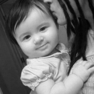 she was about 6 months old here. You know, they told me I was having a boy. She was Terek Rydell until the day she was born. June 24, 2009. How ironic eh? :)