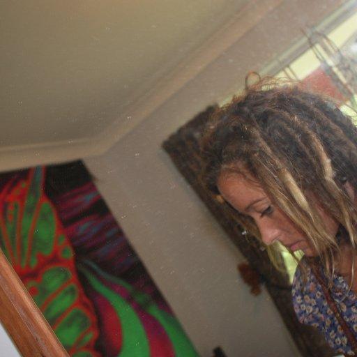 dreads r growing so gud:)
