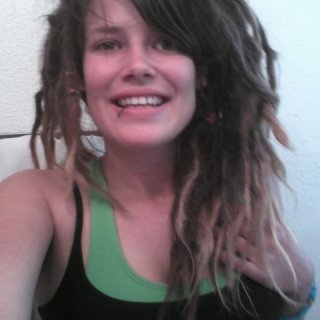 dreads are starting to tighten up and are getting shorter. can you tell how i feel about this!