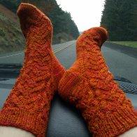 "hand-knit HP ""Fawkes"" socks"