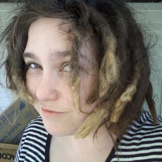 My dreads have grown so fast, the bleached out spots used to be at the root last year. Gosh how the time flies! LOL