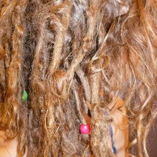 I counted 40 dreads the other night. And one section of curls which I was trying to keep but pretty sure they are dreading.