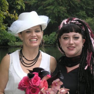 Me and my BF at her wedding - I'm the one in the black and pink. Taken almost 2 years ago.